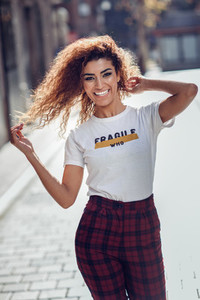 Smiling arab girl in casual clothes in the street