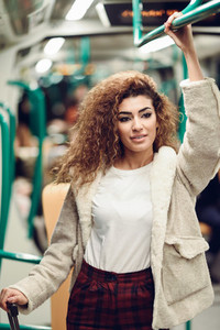 Arabic woman inside subway train Arab girl in casual clothes