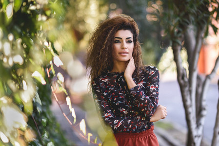 Beautiful young arabic woman with black curly hairstyle