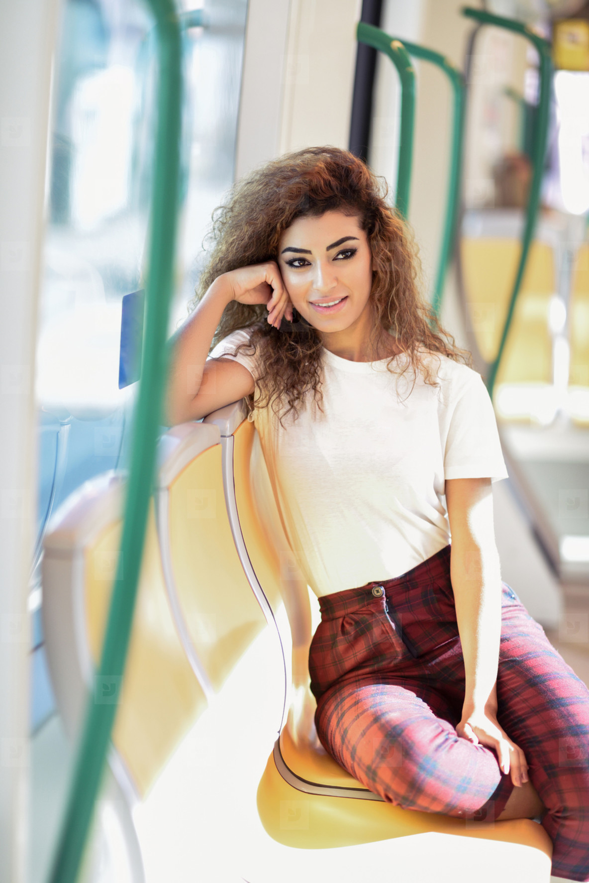 Arab woman inside metro train  Arab girl in casual clothes