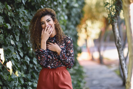 Beautiful young arabic woman laughing in urban background