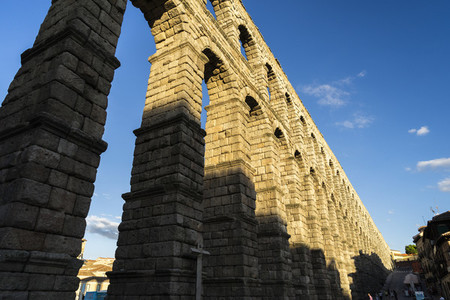 View of the famous Aqueduct of Segovia with beautiful shadow