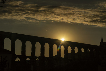 View of the famous Aqueduct of Segovia at Sunset