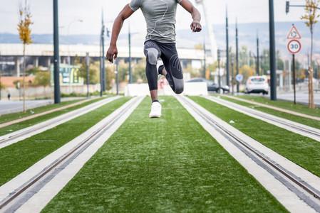Attractive black man running in urban background