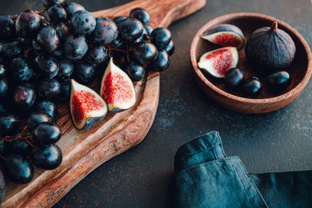 Autumn food still life with season fruits like Bangalore blue grape and figs on a table