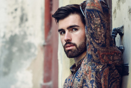 Close up portrait of young bearded man  model of fashion  in urb