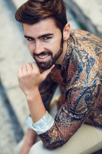 Close up portrait of young bearded man model of fashion smilin