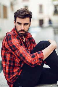 Young bearded man  model of fashion  wearing a plaid shirt with