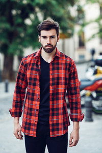 Young bearded man  model of fashion  in urban background wearing
