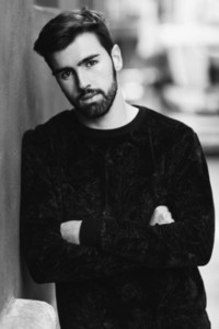 Young bearded man  model of fashion  in urban background wearing casual clothes