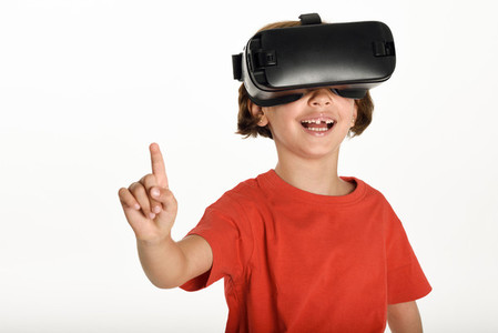 Little girl looking in VR glasses and gesturing with his hands