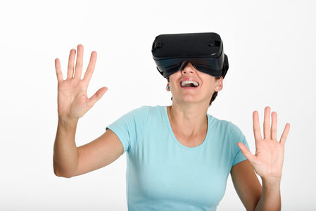Woman looking in VR glasses and gesturing with his hands