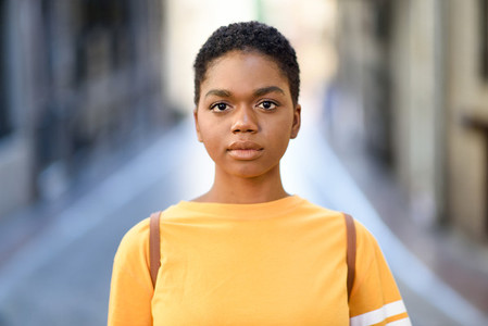 Young African woman wearing casual clothes looking at camera