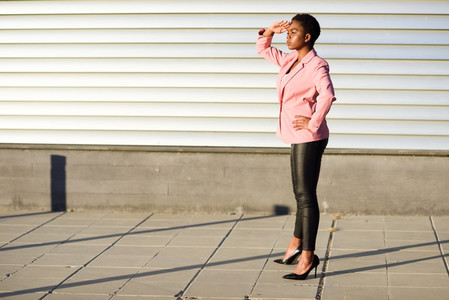 Black woman  model of fashion  standing on urban wall