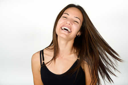 Beautiful young woman without make up on white background