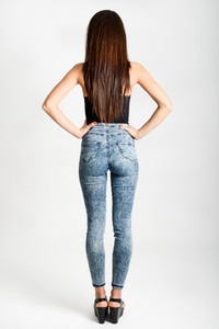 Back side of woman wearing high waisted jeans