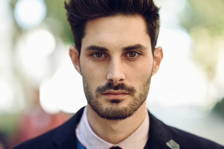 Close up of attractive man in the street in formalwear
