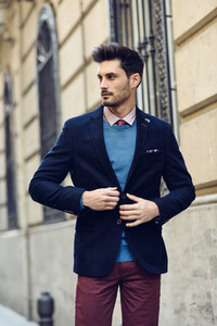 Attractive man wearing british elegant suit in the street  Moder