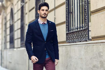 Attractive man wearing british elegant suit in the street Moder