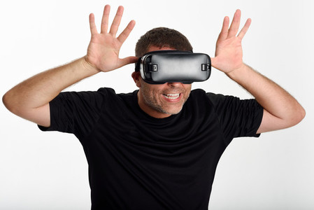 Man looking in VR glasses and gesturing with his hands