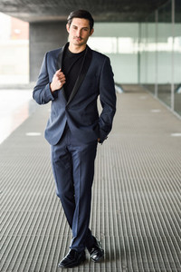 Handsome man  model of fashion  wearing modern suit