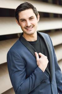 Handsome man model of fashion wearing modern suit