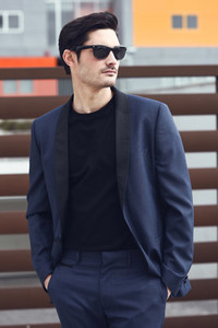 Man  model of fashion  wearing modern suit and sunglasses