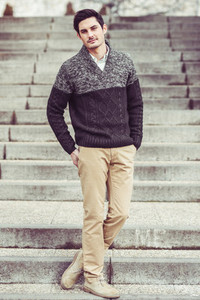 Attractive young handsome man model of fashion in urban backgro