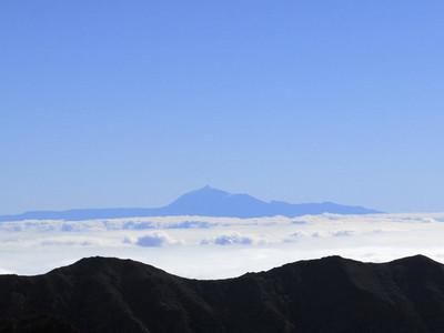 Aerial view mountain against blue sky above clouds Santa Cruz de La Palma Spain