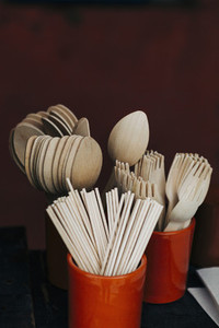 Bamboo fork spoon and chopstick utensils in crocks