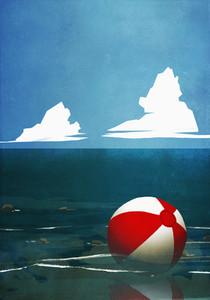 Beach ball floating on ocean