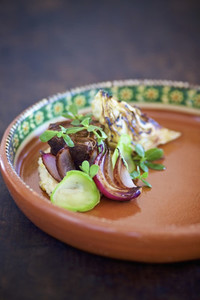 Close up gourmet grilled shallot and beef appetizer