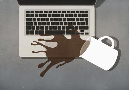 Coffee spilling on laptop keyboard