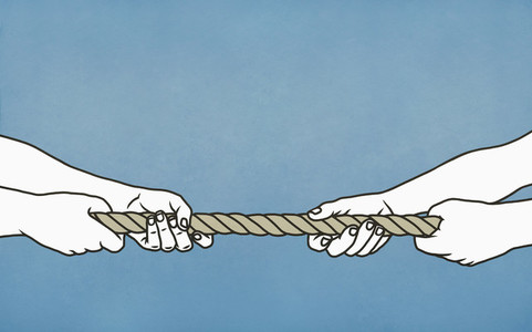 Couple playing tug of war with rope