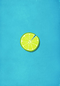 Cracked lime slice against blue background