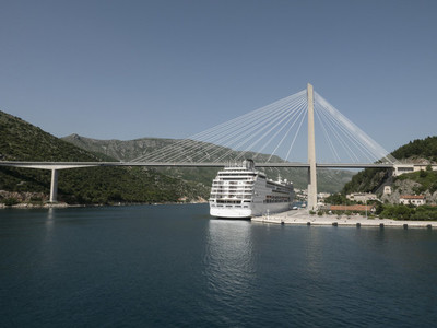 Cruise ship moored under sunny Franjo Tudjman bridge  Dubrovnik  Croatia