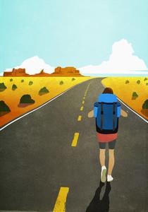 Female backpacker walking on remote arid desert road