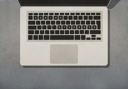Gaming Disorder text on laptop keyboard