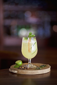 Gourmet lime margarita on wooden serving board