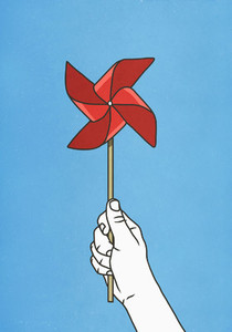 Hand holding red pinwheel