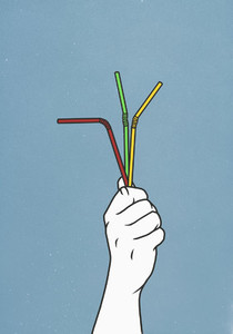 Hand holding three straws