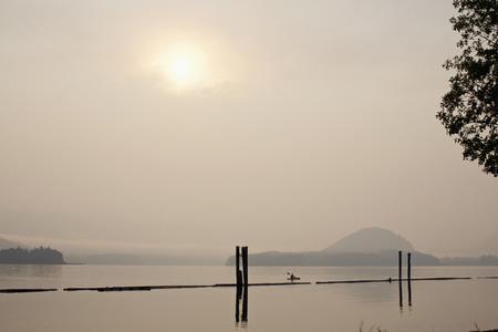 Kayak on tranquil lake Lake Cowichan British Columbia Canada