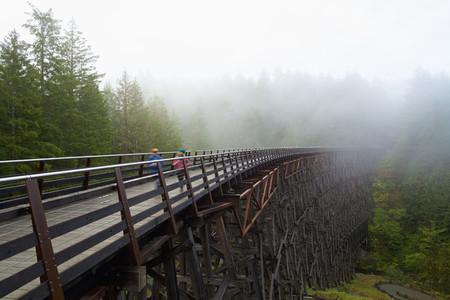 Kids running over railway trestle  British Columbia  Canada