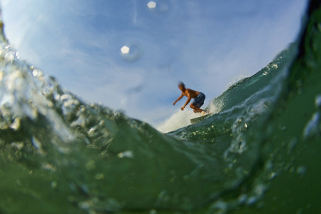 Male surfer riding ocean wave 01