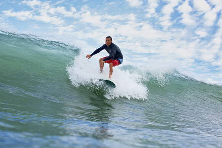 Male surfer riding ocean wave 03