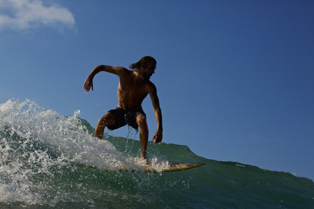 Male surfer riding ocean wave 05