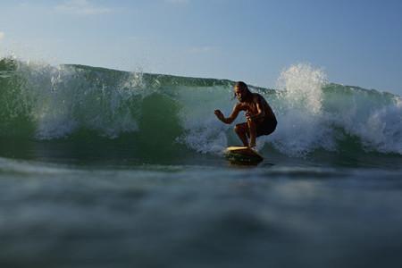 Male surfer riding ocean wave 06