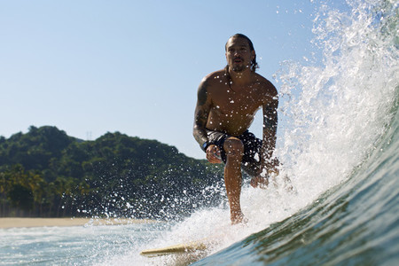 Male surfer riding sunny ocean wave 04
