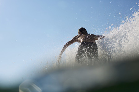 Male surfer riding wave