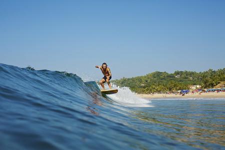 Male surfer riding wave  Sayulita  Nayarit  Mexico